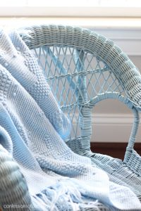 Child's wicker rocker spray painted in French Blue by Rust-Oleum.