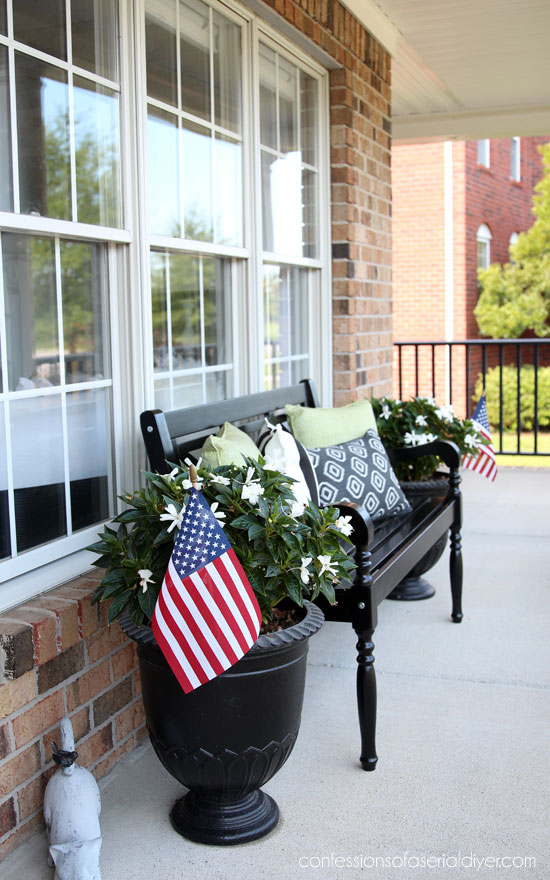 Summer front porch with black bench