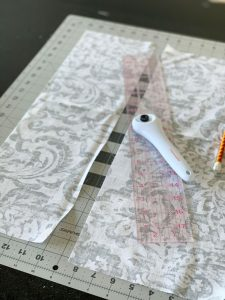 Use a rotary cutter and straight edge to cut fabric in perfectly straight pieces.