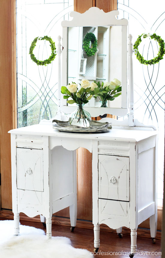 Dressing table and mirror painted white in a shabby chic distressed finish