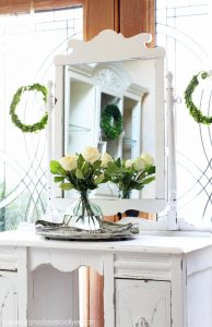 Thrift Store Mirror painted white to match a dressing table.