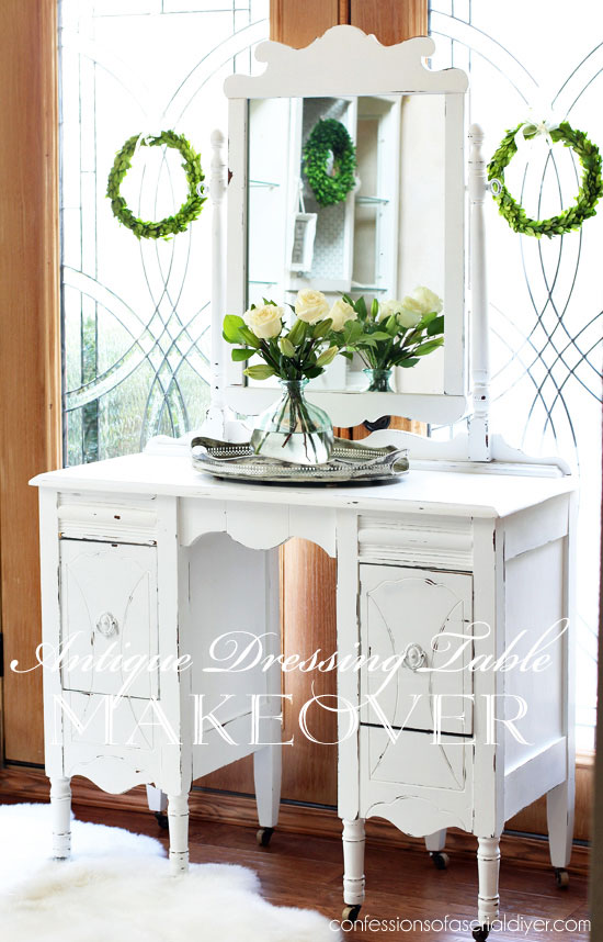 White painted dressing table with mirror, distressed with a shabby chic finish.