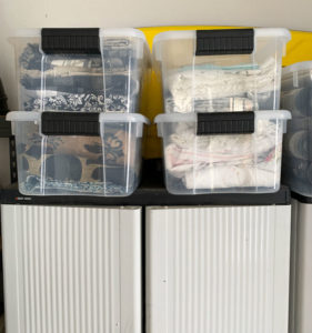 Organize fabric in clear stackable bins