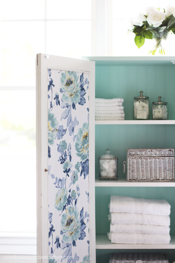 Add fabric to the back of a cabinet door for a pop of color