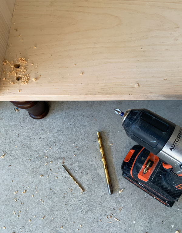 Adding feet to a cabinet