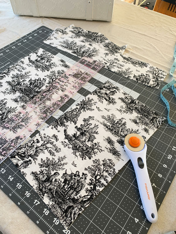 A rotary cuter and straight edge make cutting fabric so much easier!