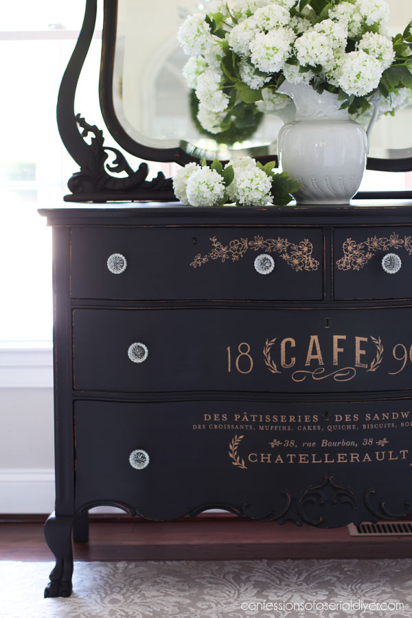 Black painted antique serpentine dresser with transfer