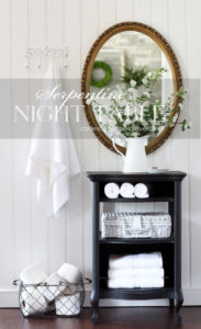 Antique serpentine night table painted in Caviar black