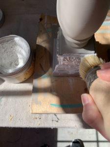 Adding white wax to candlesticks