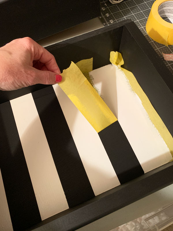 Painting the insides of drawers with stripes