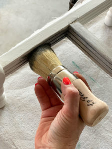 Applying wax to furniture details
