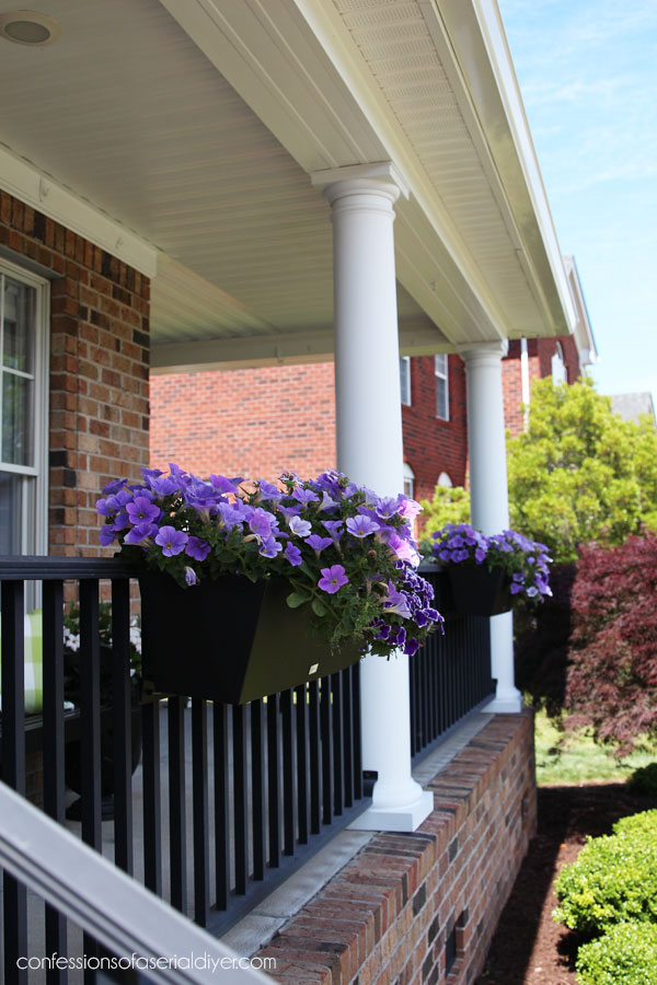 Window boxes on porch railing