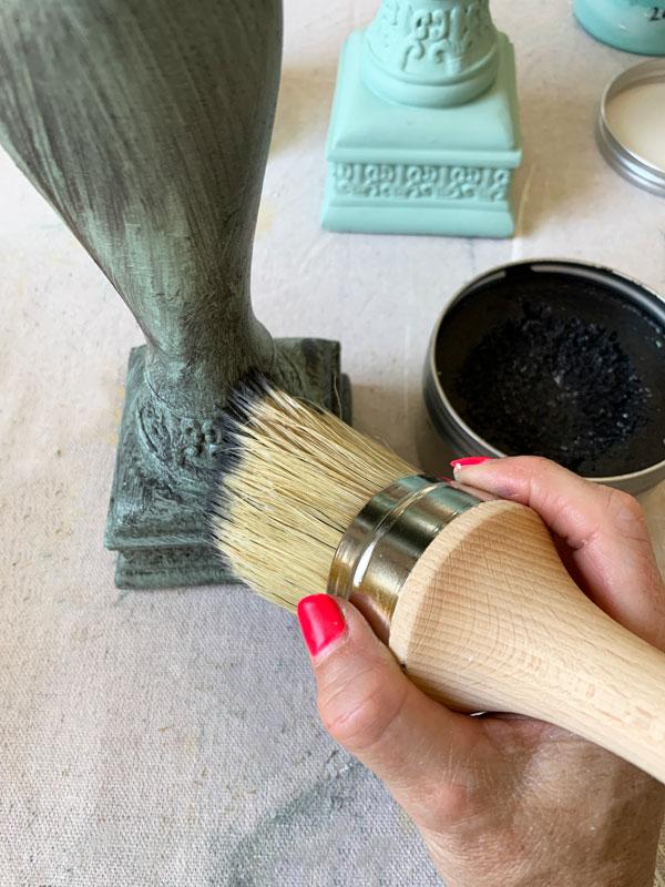 Applying black wax