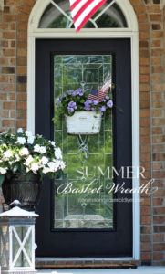 Saw a basket in half to create a one-of-kind Basket wreath!